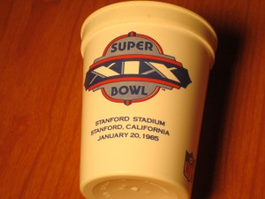 Official Souvenir Cup 1985 Super Bowl XIX at Stanford Stadium - San Francisco 49's (Coach Bill Walsh) vs Miami Dolphins (Coach Don Shula)