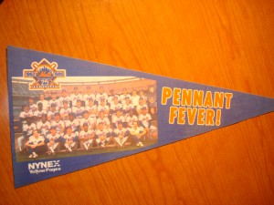 MLB - Original Souvenir Pennant for 1986  World Champion New York Mets featuring the team photo and the Mets 25 Year Anniversary Patch presented by NYNEX Yellow Pages exclaiming PENNANT FEVER !