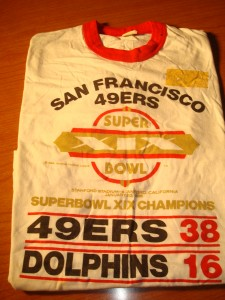 NFL - Official T-shirt Jan. 20, 1985 Super Bowl XIX from Stanford Stadium, CA featuring San Francisco 49'ers (Coach Bill Walsh) vs Miami Dolphins (Coach Don Shula) - 49'ers win 38-16