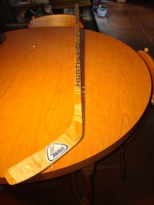 NHL - Original 1976 Team Autograph Hockey Stick for WHA Houston Aeros featuring MVP Winner Gordie Howe and his sons Mark and Marty