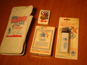 Official 1984 Los Angeles Olympics Souvenier Sunglass Case, Cigarette Lighter, Deck of Playing Cards & Hotel Bath Soap