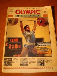 Official August 5, 1984 Edition of The Olympic Record Day 8 featuring Men's Weightlifting Competition and Track & Field Men's 400m Hurdler USA's Edwin Moses