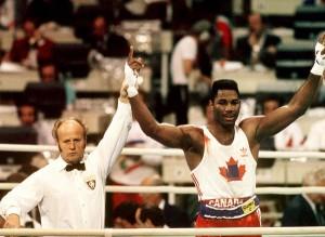 Canada's Lennox Lewis celebrates after winning the gold medal in boxing at the 1988 Olympic Games in Seoul. (CP Photo/ COA/S.Grant) Lennox Lewis du Canada célèbre sa médaille d'or en boxe aux Jeux olympiques de Séoul de 1988. (PC Photo/AOC)