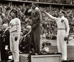Photo of Olympics – 1936 – Track + Field Legend Jesse Owens – The Buckeye Bullet – Host Paul Hornung