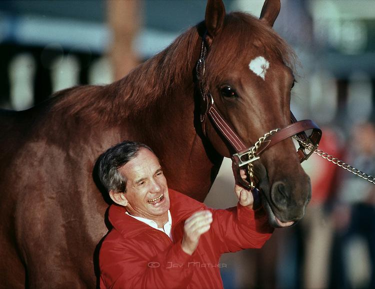 Photo of Horse Racing – 1986 – ESPNs Kentucky Derby Pre Race Festivities – Host Greg Gumbel + Sharon Smith