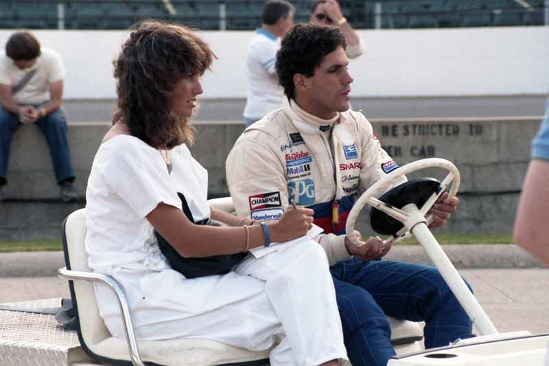Photo of Auto Racing – 1987 – ABCs Jerry Gappens In Race Interview With Driver Roberto Guerrero Wife Katie