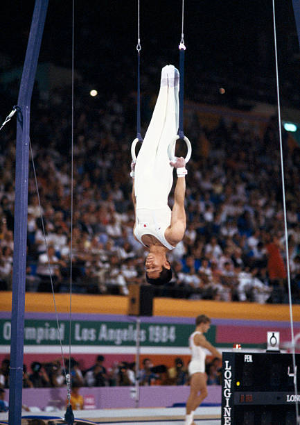 Photo of Olympics – 1984 – L A Games – Mens Gymnastics Rings Finals – Winners JPN Koji Gushiken + CHN Li Ning