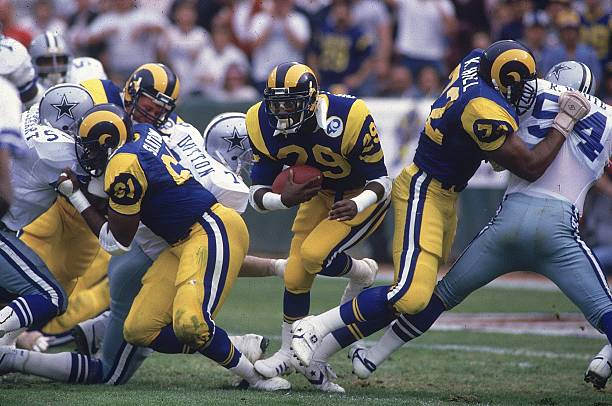 Photo of NFL – 1986 – NFC Divisional Playoffs Cowboys Vs Rams Halftime With Brent Musburger + Joe Montana