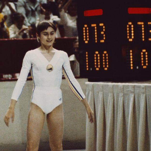 Photo of Gymnastics – 1980 – Exhibition Women's Floor Exercise – ROM Nadia Comaneci   With Jim McKay