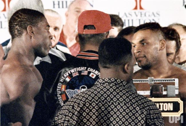 Photo of Boxing – 1989 – Talk About Machismo – Mike Tyson Gestures Frank Bruno At Their Title Fight Weigh In