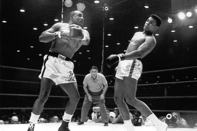 Photo of Boxing – 1964 – Heavywt Title Fight Weigh In As Cassius Clay Renders Himself Immune To Sonny Liston