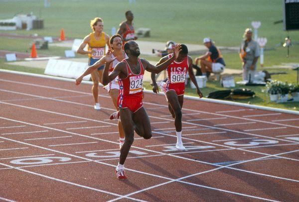 Photo of Olympics – 1984 – L A Games – 400m Hurdles Finals – USA Moses 1st +  USA Harris 2nd + FRG Schmid 3rd
