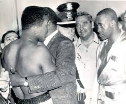 Photo of Boxing – 1964 – Cassius Clay Muhammad Ali Goes Crazy At Heavywt Title Weigh In With Sonny Liston