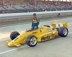 Photo of Auto Racing – 1986 – Indy 500 – Larry Nuber PreRace Interview With Driver Al Unser Sr