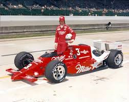 Photo of Auto Racing – 1987 – Indy 500 – Jack Arute In Race Interview With Driver Danny Sullivan In His Pits