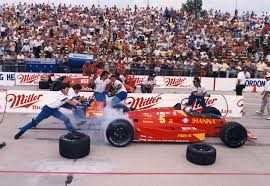 Photo of Auto Racing – 1987 – Indy 500 – Al Trautwig With Hard Luck Drive Mario Andretti After Engine Failure