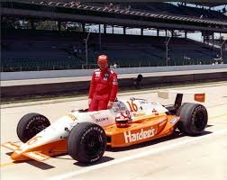 Photo of Auto Racing – 1987 – Indy 500 – Al Trautwig In Pits With Tony Bettenhausen Crew On Intercom Issues