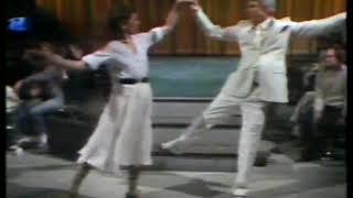 Photo of Music – 1983 – Fascination – As Steve Martin + Gilda Radner Perform A Spontaneous Dance  Routine