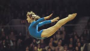 """Photo of L E's Stories – """"The Sparrow From Minsk Who Changed Women's Gymnastics Forever"""" – The Story Of Olga Korbut Of The Soviet Union"""