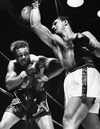 "Photo of L E's Stories – Friday Night Gillette Cavalcade Of Sports + ""The Mongoose"" = Pops And Los Tres Hermanos Around The TV"" – A Tribute To Boxing Legend Archie Moore"
